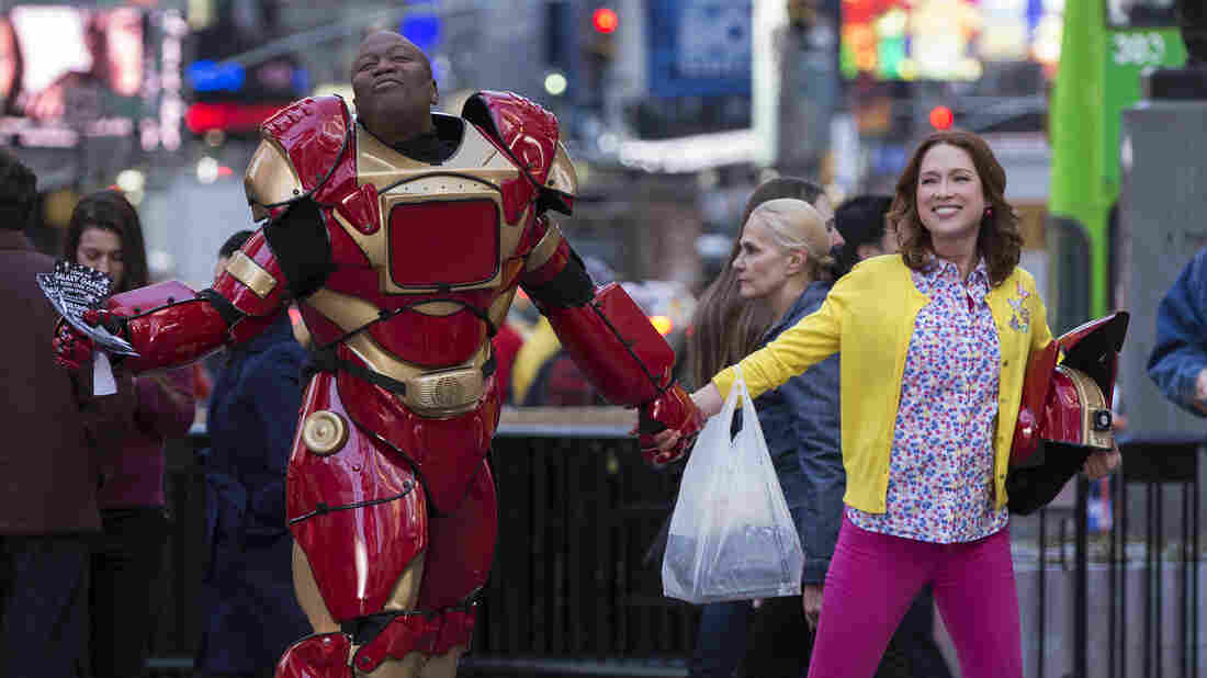 Ellie Kemper, right, stars alongside Tituss Burgess in Netflix's Unbreakable Kimmy Schmidt, which follows a former doomsday cult member as she adjusts to life in New York.