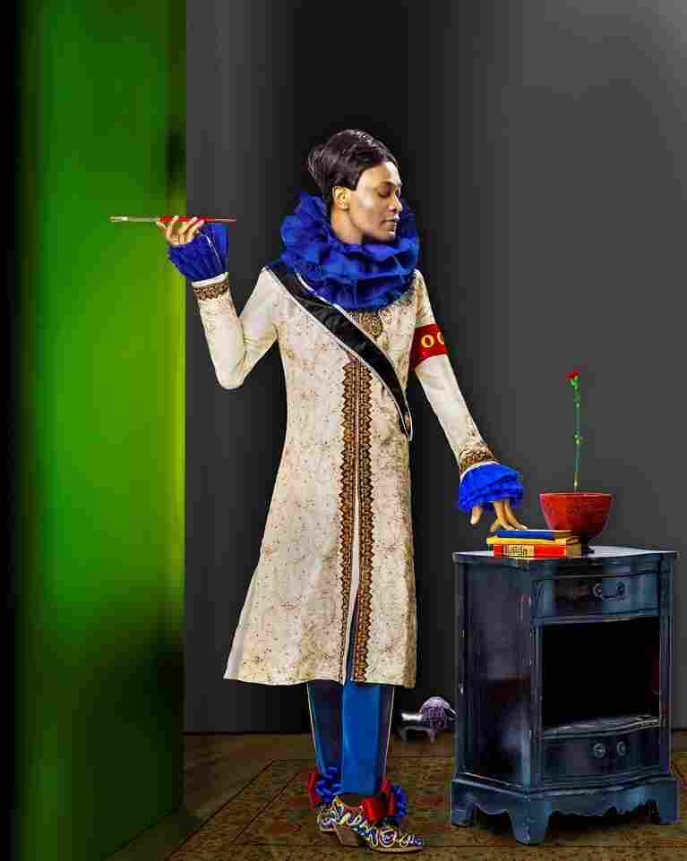 Udé wears a formal Indian men's gown, 1950s marching band trousers and 17th-century men's shoes in Sartorial Anarchy #24.