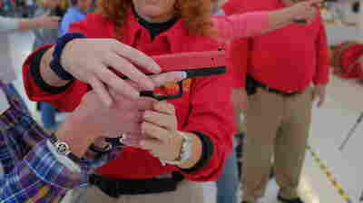 Colorado educators take part in a concealed carry course in Englewood, Colo. on Nov. 8. State school employees who complete the training are eligible to apply for a permit to carry a handgun.