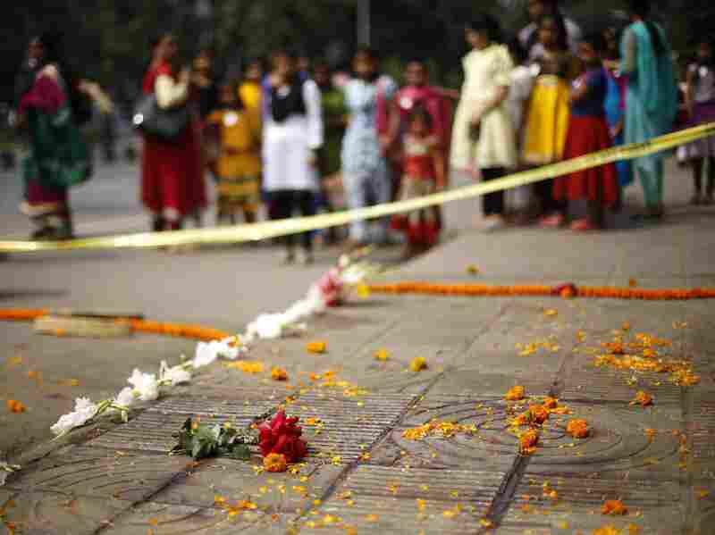 People gather on the spot where Bangladeshi blogger Avijit Roy was killed in Dhaka, Bangladesh, on Thursday.