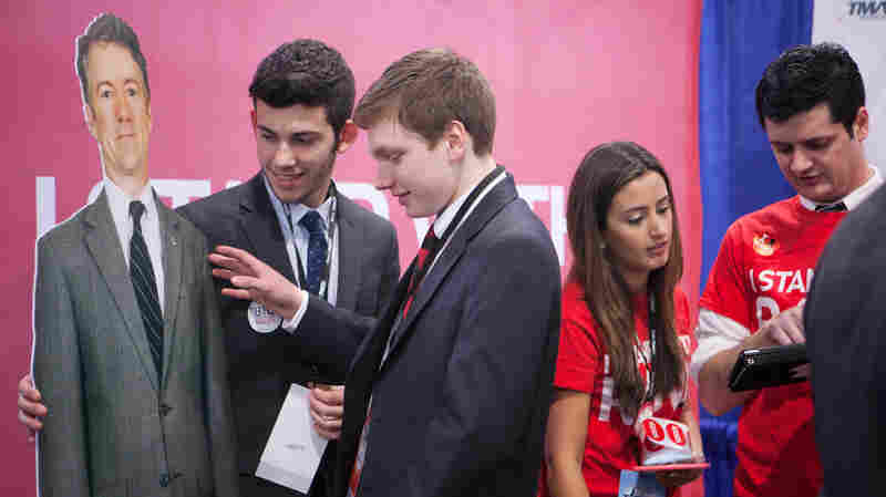Josh DiNatale (left) and Zachary Burns, St. Joseph's University students and members of their College Republicans chapter, get ready to pose for a photo with a cutout of Sen. Rand Paul at CPAC 2015.