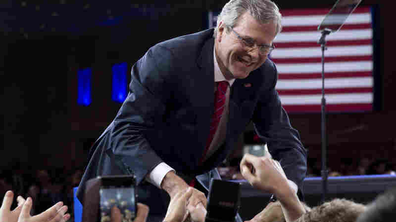 Former Florida Gov. Jeb Bush shakes hands with the audience after speaking at CPAC Friday.