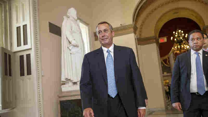 House Speaker John Boehner of Ohio walks to the House chamber on Capitol Hill in Washington, on Friday.