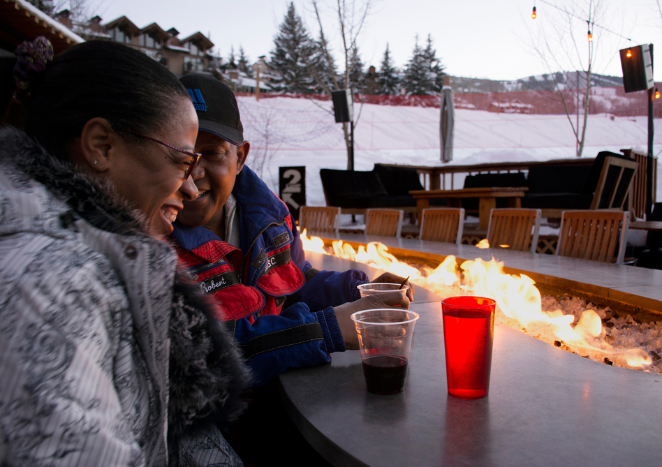 "Lorna Anderson (left), of Palm Gardens, Fla., enjoys apres ski with her new friend, Robert Gibson of Detroit. Though they've attended the Black Ski Summit for more than 20 years, they first met this weekend. Robert Gibson says, ""I feel like I've known her forever, but we just met Sunday. Timing is everything and now is the right time."""