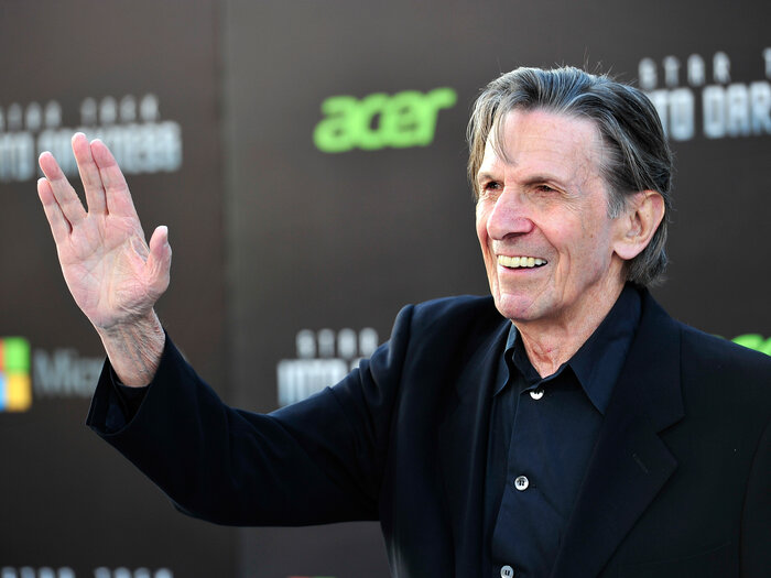 Nimoy flashes the famous Vulcan salute at the 2013 premiere of Star Trek: Into Darkness. He originally based the gesture on a Jewish blessing.
