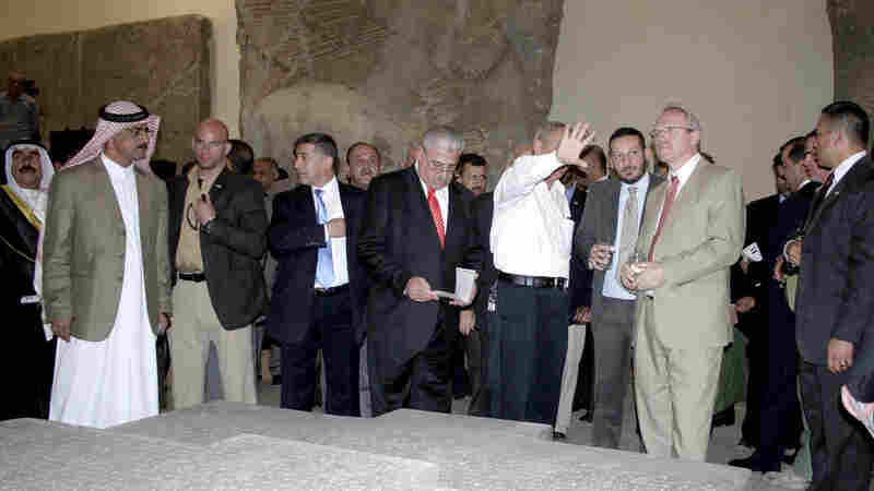 Then-U.S. ambassador to Iraq Christopher Hill (right) tours the Mosul Museum of History in May 2009. This week the self-declared Islamic State posted a video online that showed militants going through the museum, pushing over statues and smashing artifacts with sledgehammers.