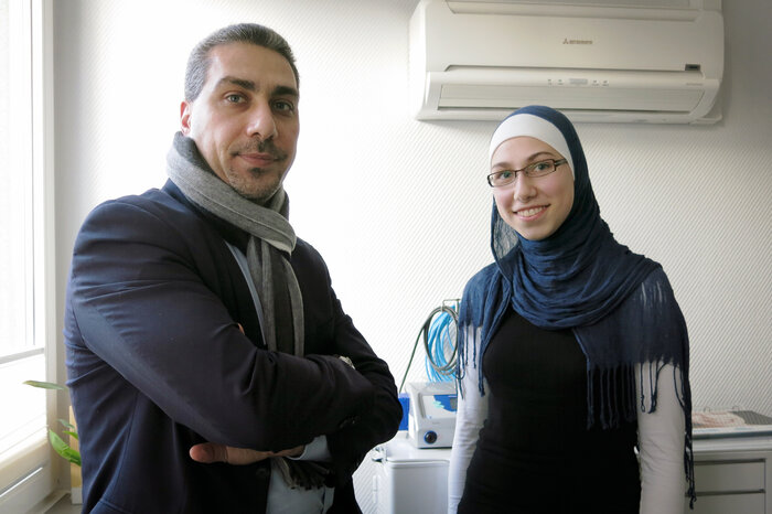 Born in Syria, Mousllie (shown here with his 17-year-old daughter, Sarah) came to Germany more than 20 years ago and is now a German citizen.