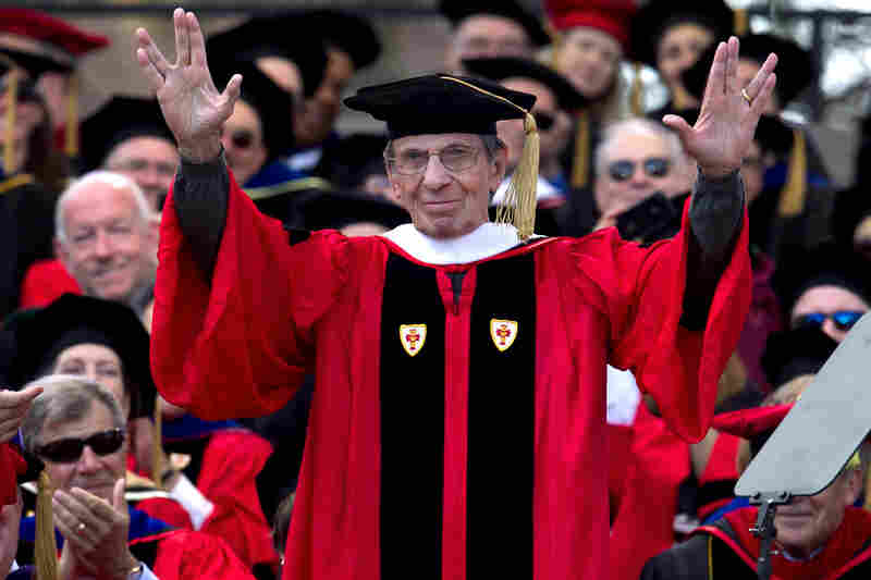 "Actor Leonard Nimoy gives a ""live long and prosper"" sign after being awarded an honorary doctor of humane letters degree during Boston University's commencement exercises in 2012. The gesture was made popular by Nimoy's character Spock in the TV science fiction series Star Trek."
