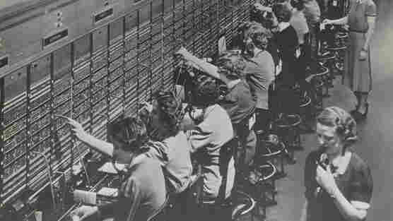 Operators at a Bell System telephone switchboard, as photographed by the Department of Labor Women's Bureau.