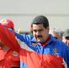 Venezuelan President Nicolas Maduro waves to supporters during a march in Caracas, Venezuela, on Saturday.