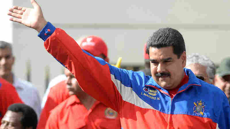 Venezuelan President Nicolas Maduro waves to supporters during a march in Caracas, Venezuela, on Saturday.