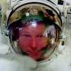 Astronaut Terry Virts points to his helmet as he sits inside the International Space Station on Wednesday.
