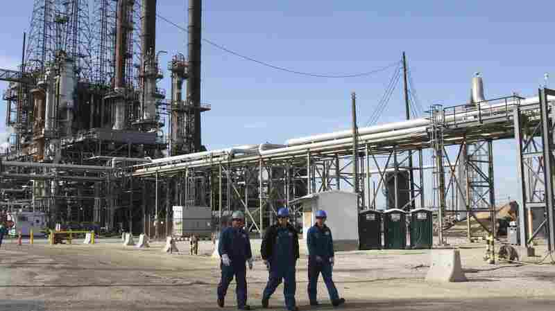 Workers walk inside the LyondellBasell oil refinery in Houston in 2013. Lower oil prices are stoking fears of an economic decline in the region.