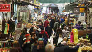 Shoppers walk through a market in downtown Jerusalem last November, shortly before Israel's coalition government collapsed. As Israel prepares for elections on March 17, the diverse population has very different notions of what the country should look like.