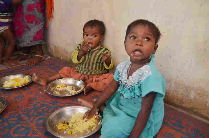 Toddlers enjoy a lunch of eggs and rice at a Fulwari in Haramar, a tribal village in northern Chhattisgarh.