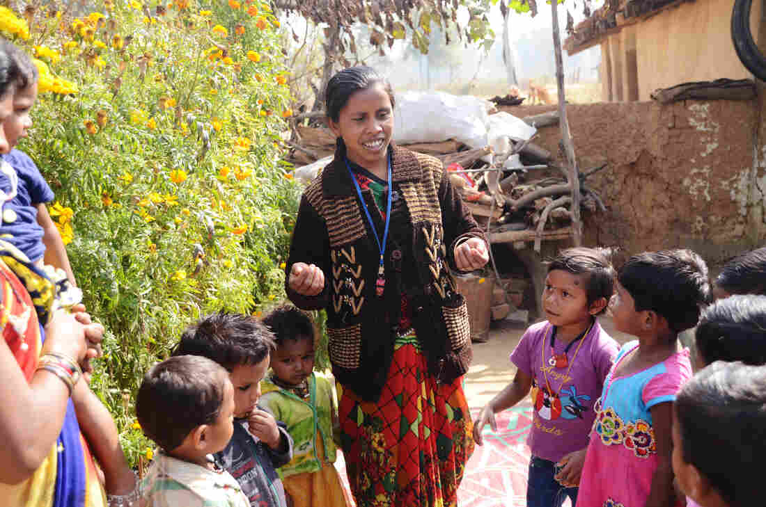 Nursery worker Shivkumari Pate leads children in a learning song. Pate works with the nonprofit Jan Swasthya Sahyog, which developed the first network of community nurseries.