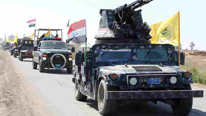 Members of Iraqi security forces drive toward an area south of Tikrit this weekend. An Iraqi force has launched a military offensive, hoping to push ISIS out of Tikrit.