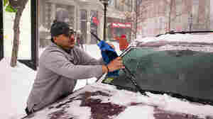 A driver clears his car windshield in Boston on Jan. 27, after a heavy storm hit the city. Pennsylvania could be the next state to pass legislation that would cite drivers that take to the road before removing the hazardous ice and snow.