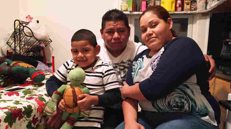 Wilfredis Ayala, an unauthorized immigrant from El Salvador, lives in Long Island, N.Y., with his U.S.-born son Justin and Justin's mother Wendy Urbina.