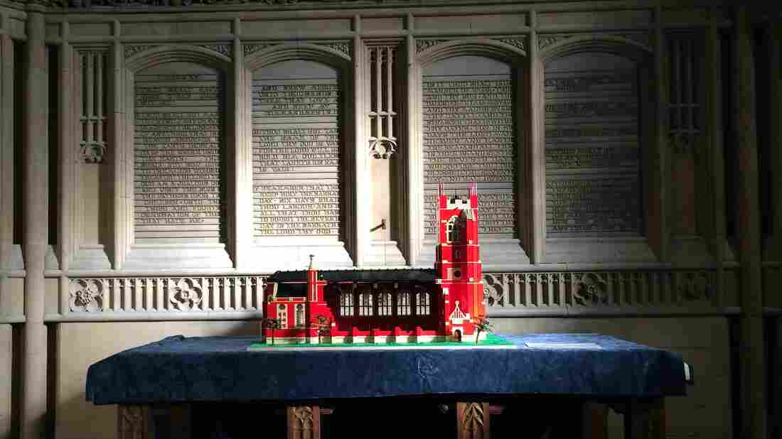 A Lego model of All Souls Church rests on the altar, which was retained when the Bolton, England, church was renovated into an interfaith community center. The model was built by children taking part in an after-school program there.