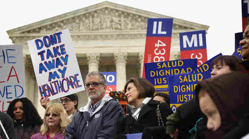 Supporters of the Affordable Care Act gather in front of the U.S Supreme Court during a rally Wednesday. The court heard arguments in the case and is expected to announce its decision in June.