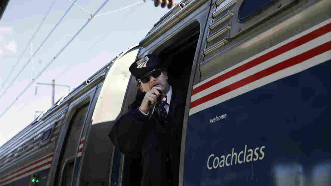 Amtrak conductor Michael Laubauskas talks on a radio Feb. 19 as his train departs Trenton, N.J., for Washington, D.C. The U.S. House passed an Amtrak funding bill Wednesday that splits Amtrak's high-ridership Northeast Corridor line that runs from Boston to Washington from the less profitable part of the system.