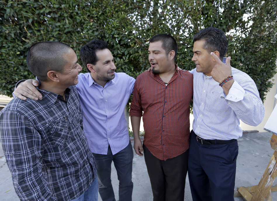 Scott Budnick (second from left) stands with (from left) Jimmy Wu, who served 16 years in prison and is now a mentor; Jesse Aguiar, former gang member and now a counselor; and Franky Carrillo, who was freed by the Innocence Project after 21 years in prison. (Reed Saxon/AP)