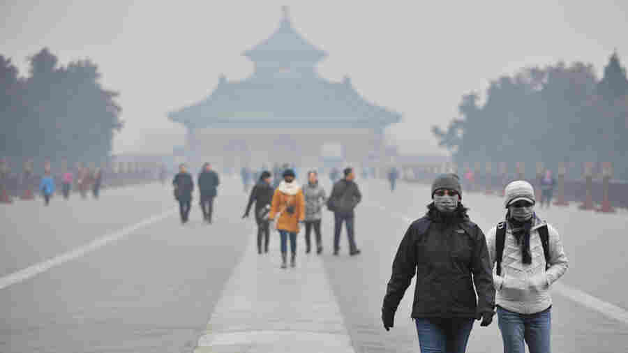 Tourists wear facial masks while visiting the Temple of Heaven Park in Beijing in January.