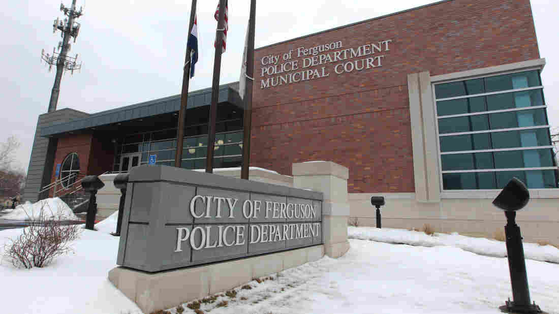 The Ferguson, Mo., police department is criticized in a new Justice Department report. The department says there is no evidence to warrant civil rights charges over the death of Michael Brown last August.