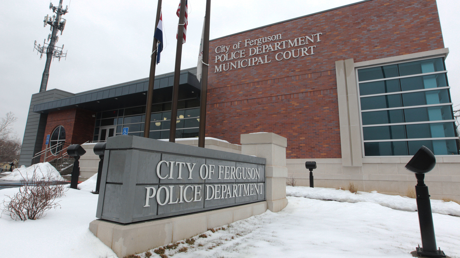 The Ferguson, Mo., police department is criticized in a new Justice Department report. The department says there is no evidence to warrant civil rights charges over the death of Michael Brown last August. (BILL GREENBLATT/UPI /Landov)