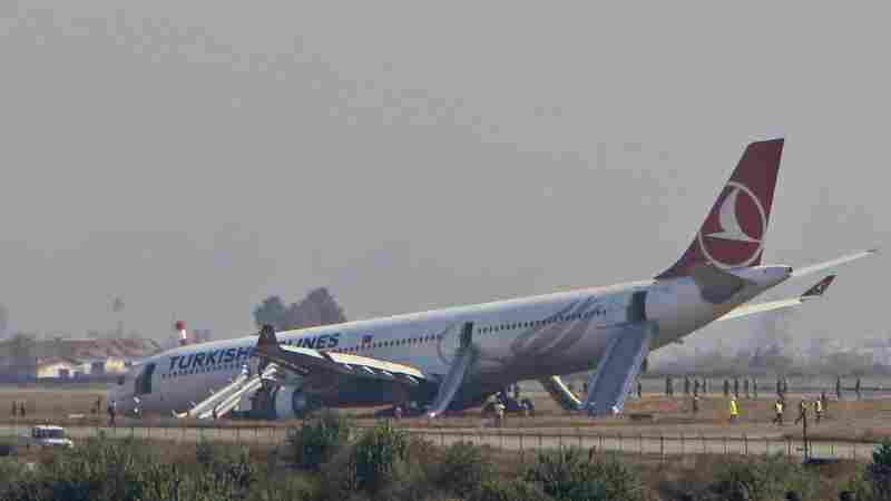 A Turkish Airlines jet is seen after it skidded off a slippery runway Wednesday while landing in dense fog at Tribhuwan International Airport in Kathmandu, Nepal.