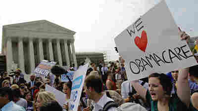 Supporters of the Affordable Care Act celebrate outside the Supreme Court in 2012, after a divided court upheld the la