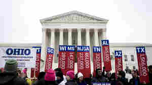 Fans and foes of Obamacare jockeyed for position outside the Supreme Court Wednesday. Inside, the justices weighed arguments in the case of King v. Burwell, which challenges a key part of the federal health law.