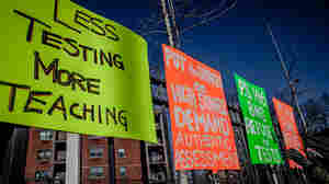 Signs posted by parents in Brooklyn, N.Y., call for opting out of state-mandated testing.