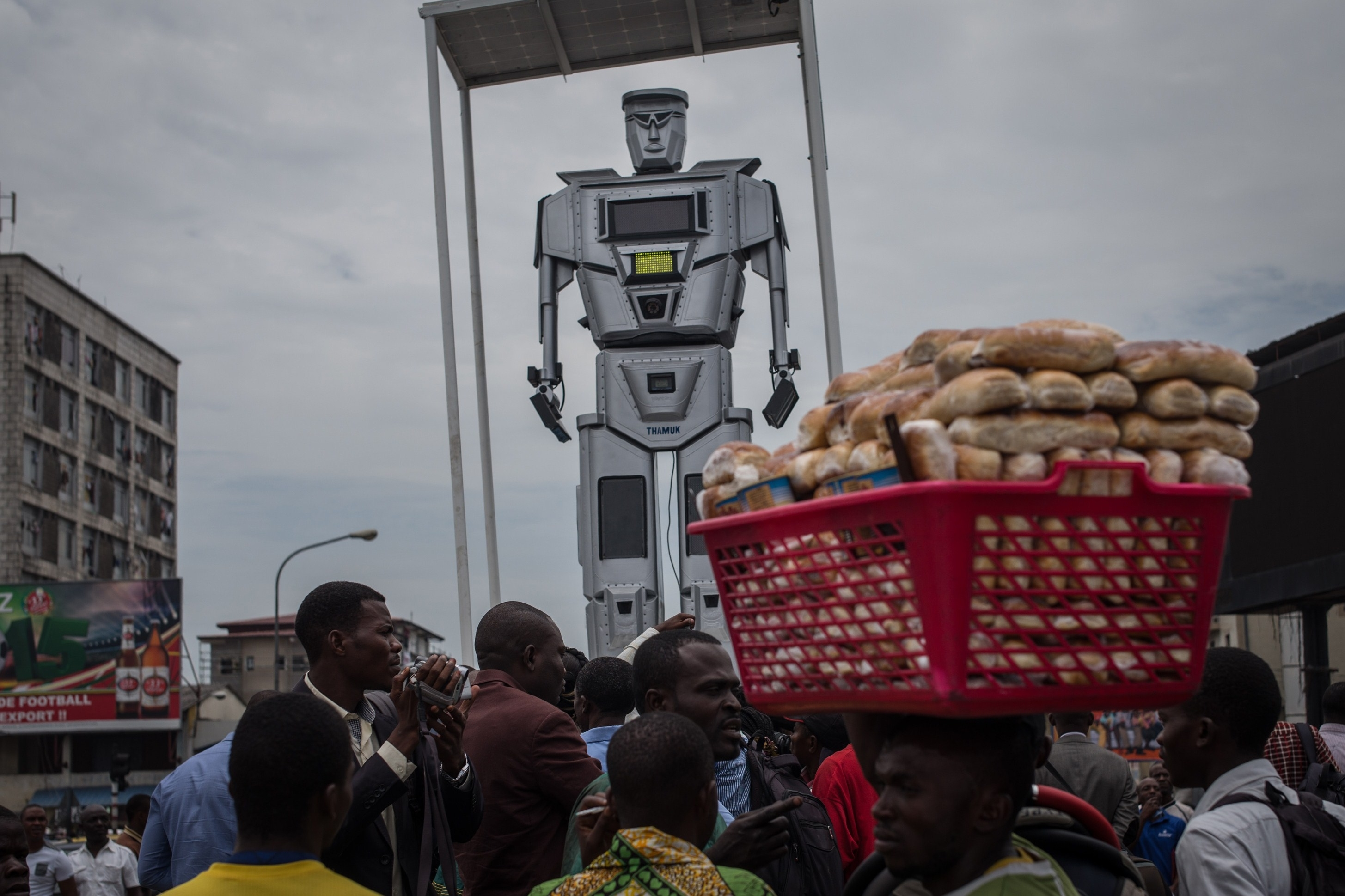 'Respect The Robot': Giant Robots Oversee Traffic In Kinshasa