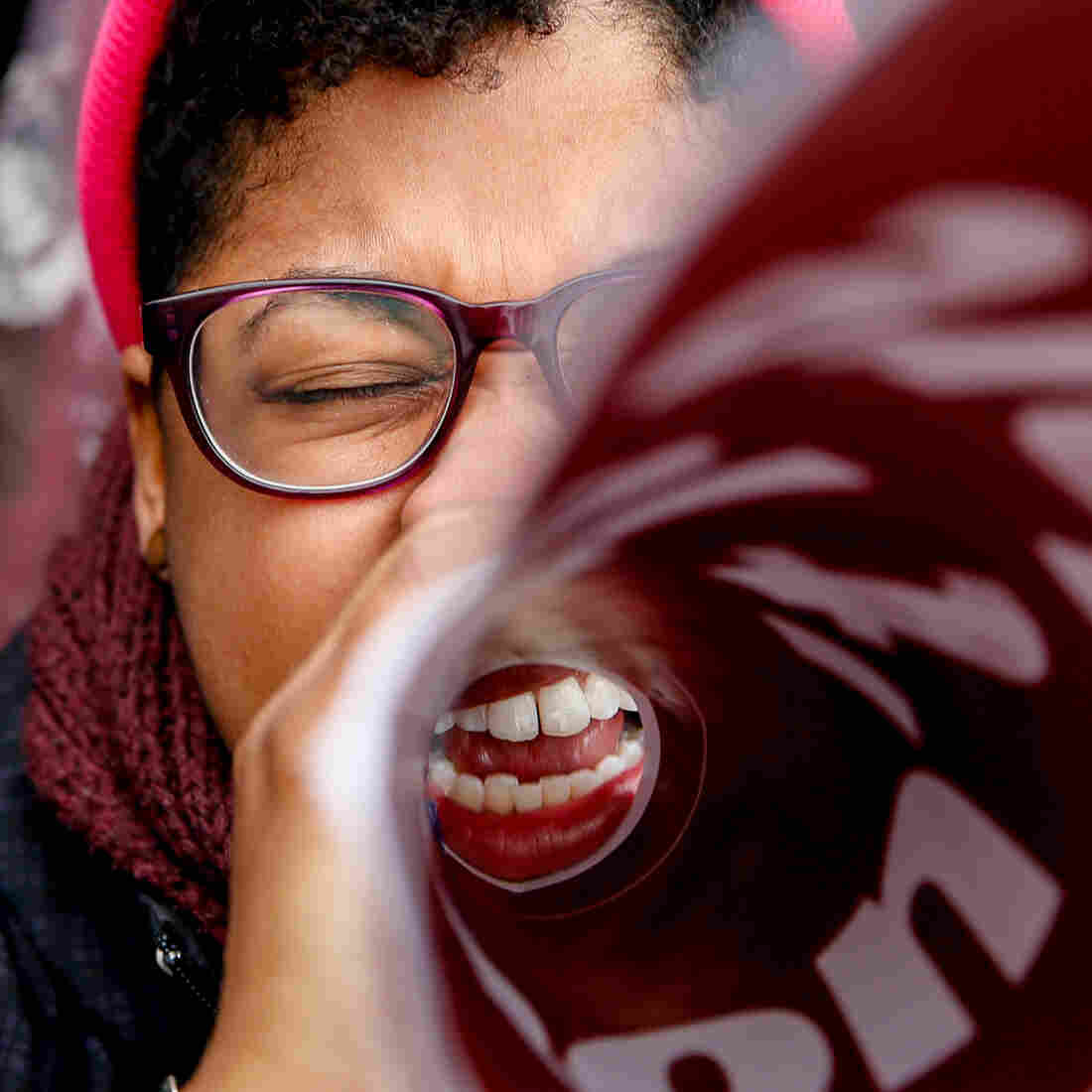 Latoya Watson of Washington, D.C., cheers during a rally outside the Supreme Court on Wednesday, when the justices heard arguments in King v. Burwell.