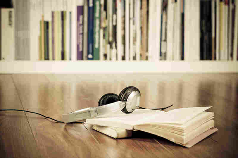 Headphones on top of a book