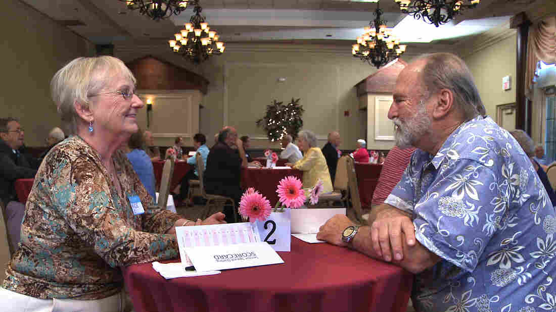 Janice Ledtke and Pacho Lane chat during a speed dating event in The Age of Love.
