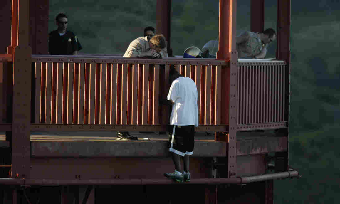 Kevin Berthia is talked down by California Highway Patrol Officer Kevin Briggs at the north tower of the Golden Gate Bridge in 2005.