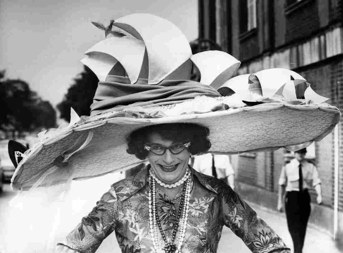 Dame Edna Everage — a character created by Australian comedian Barry Humphries — models a hat based on the Sydney Opera House. She is currently performing Dame Edna's Glorious Goodbye: The Farewell Tour.