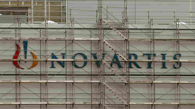 """Swiss drugmaker Novartis' logo is seen behind scaffolding at the company's plant in the northern Swiss town of Stein, shown in January. The company's """"biosimilar"""" drug Zarxio has received FDA approval."""