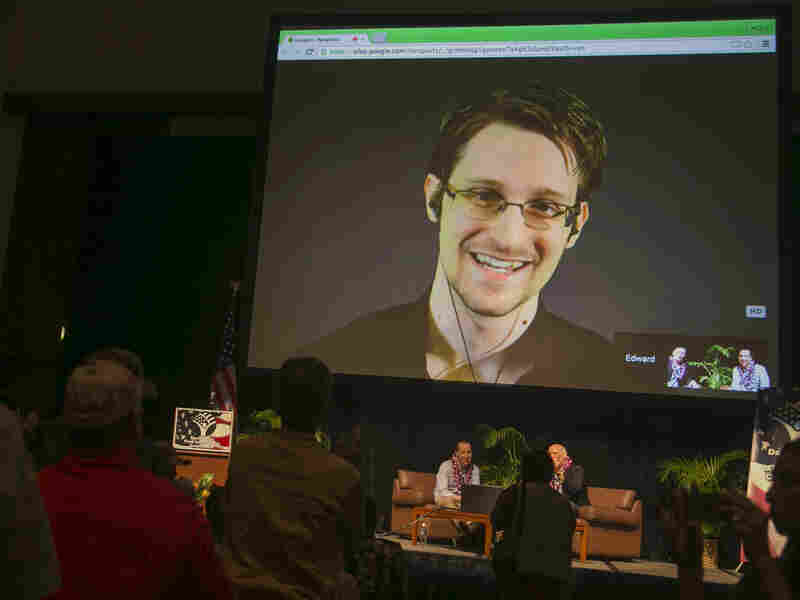 National Security Agency leaker Edward Snowden appears on a live video feed broadcast from Moscow at an event sponsored by the ACLU Hawaii in Honolulu on Feb. 14.