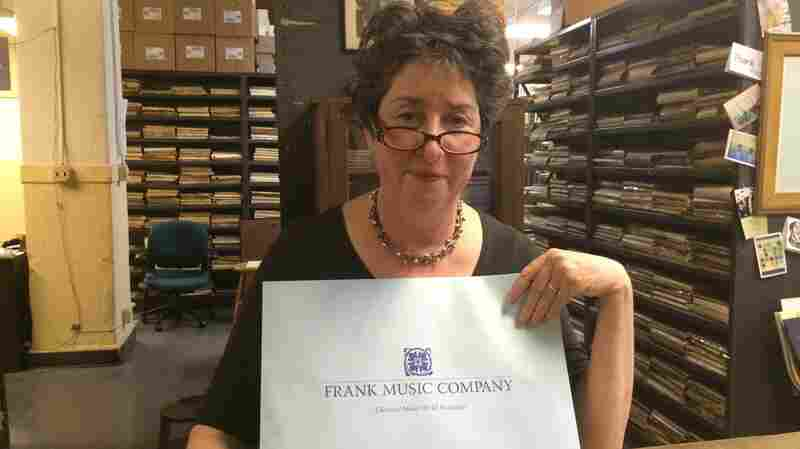 Owner Heidi Rogers Tuesday at her famous Manhattan shop, Frank Music Company, before the store's final closing Friday. Judging silently from on high is composer Igor Stravinsky.