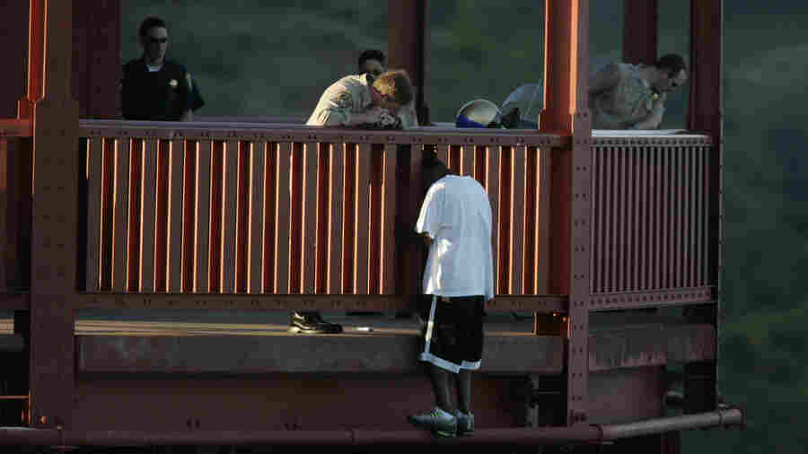 Kevin Berthia is talked down by California Highway Patrolman Kevin Briggs at the north tower of the Golden Gate Bridge in 2005.
