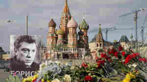 A portrait of Kremlin critic Boris Nemtsov and flowers photographed on Friday at the site where he was killed on February 27, with St. Basil's Cathedral seen in the background.