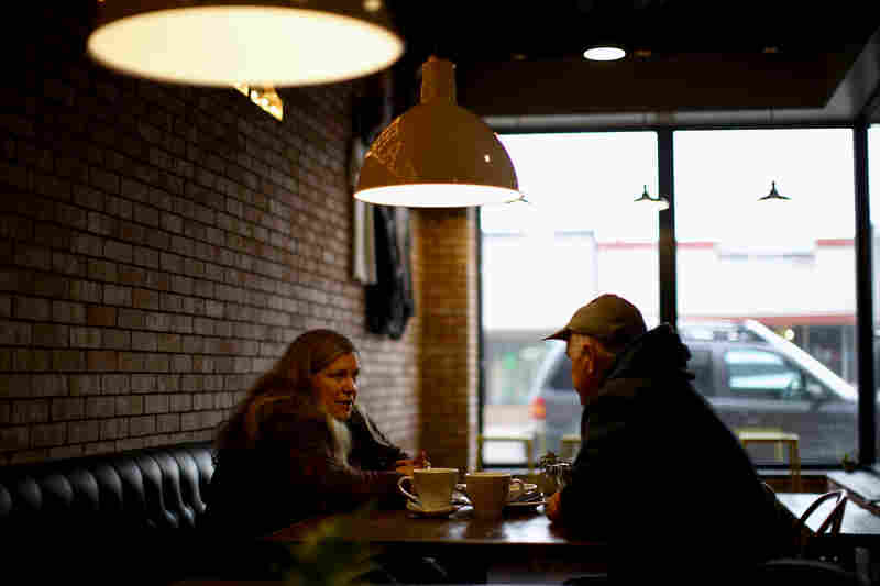Customers enjoy a conversation while dining at one of Sidney's main street restaurants that serves coffee in the morning and craft beers at night.