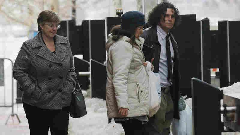 Boston Marathon bombing survivor Karen Brassard (left) and bombing witness Carlos Arredondo (right) leave a federal courthouse last week during the trial of accused bomber Dzhokhar Tsarnaev in Boston.