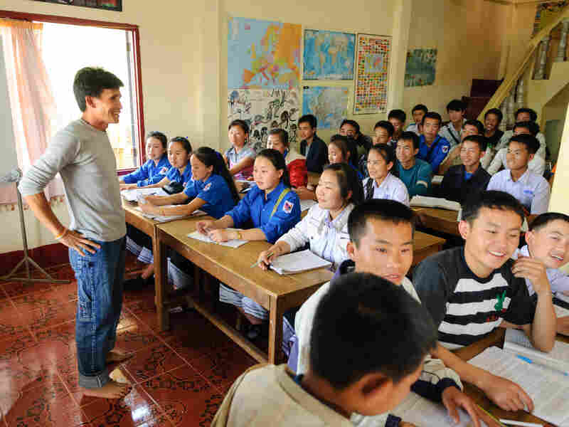 Manophet talks with an English language class at the school he set up in a house on the outskirts of Phonsavan, Laos.