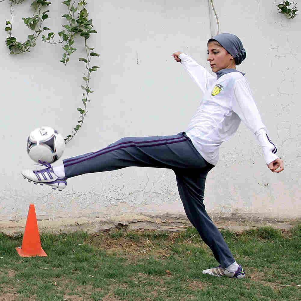 Members of a Saudi women's soccer team, Rana Al Khateeb (left) and captain Rawh Abdullah, practice at a secret location in the capital Riyadh in 2012. Saudi women have had only rare opportunities to play sports. The country sent women to the Olympics for the first time in 2012 and now girls will be allowed to take physical education classes at public schools.