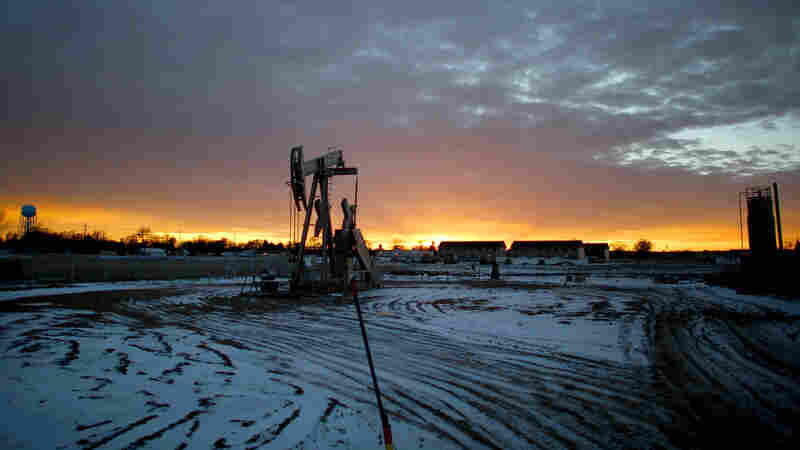 A pump-jack sits atop an oil well near downtown Sidney, Mont. The oil boom has brought thousands of new residents to the town, almost all of whom work in the Bakken oil fields in Montana and North Dakota. Sidney sits at the western edge of the Bakken oil patch, one of the most productive drilling areas in the country.